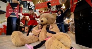 Enjoying the opening of the FOA Schwarz Toy store at Arnotts: Some 6,500 families visited Santa in Arnotts, a record for the store. Photograph: Alan Betson