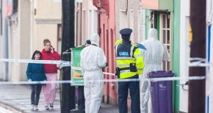 A Garda forensic team at the house on Bandon Road, Cork,  where Cameron Blair was stabbed. Photograph: Daragh Mc Sweeney/Provision