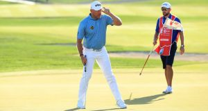 Lee Westwood leads by one heading into the final round in Abu Dhabi. Photograph: Andrew Redington/Getty