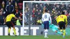 Tottenham's Paulo Gazzaniga saves Troy Deeney's penalty. Photograph: Richard Heathcote/Getty