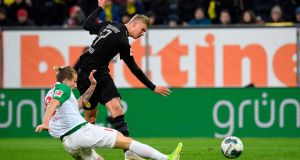 Erling Braut Haaland  scores his first goal for Borussia Dortmund against Augsburg. Photo: Getty Images