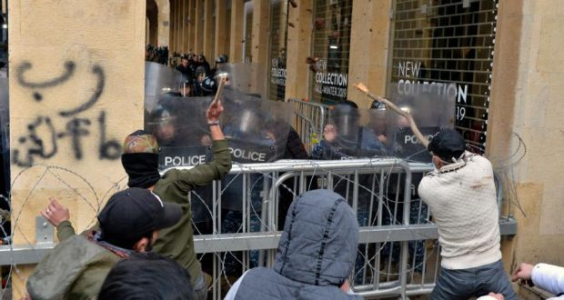 Anti-government protesters clash with Lebanese riot police during a protest outside of the parliament in downtown Beirut on January 18th. Photograph: Wael Hamzeh/EPA