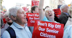 Medical card protests in 2008. 'It is in the narrow economic interests of older people to receive higher State pensions at as young an age as possible.'  Photograph: Bryan O'Brien
