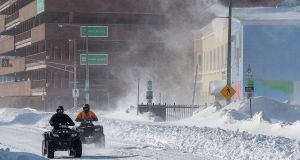 Two all-terrain vehicles cruise through downtown St John's Newfoundland. Photograph: Andrew Vaughan/The Canadian Press via AP