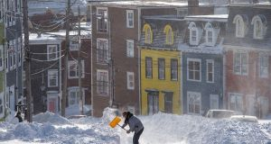A resident digs a path from his house in St. John's, Newfoundland on Saturday,. Photograph: Andrew Vaughan/The Canadian Press via AP