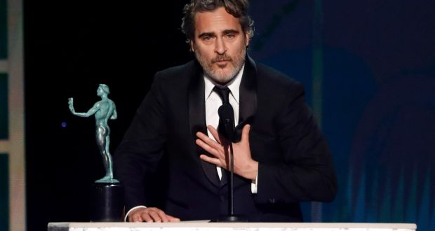 Joaquin Phoenix accepts the Screen Actors Guild award for outstanding performance by a male actor in a leading role for  Joker. Photograph: Mario Anzuoni/Reuters