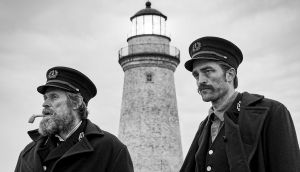Robert Pattinson stars as Ephraim Winslow and Willem Dafoe stars as Thomas Wake in The Lighthouse (2019) Photo: Eric Chakeen/A24
