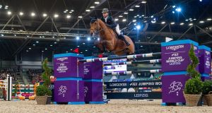 Denis Lynch of Ireland riding GC Chopin's Bushi to victory at the Longines FEI World Cup in Leipzig, Germany. Photograph:  Thomas Reiner/FEI
