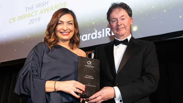 Gerard O'Neill, Awards Judge & Amárach Research presents the CX Impact in Pharmacy/Health award to Oonagh O'Hagan, Meaghers Pharmacy Group.