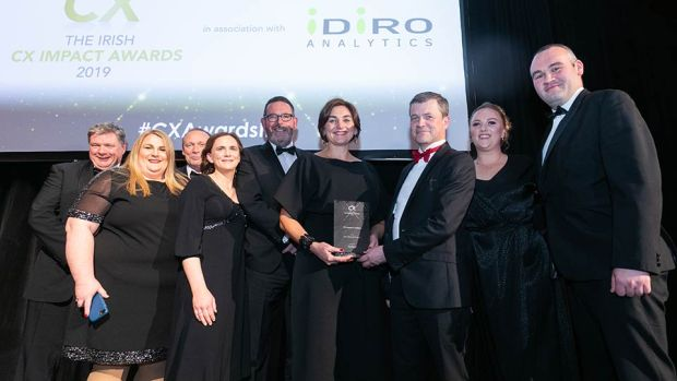 Aidan Connolly, CEO, Idiro Analytics presents the CX Impact in Utilities award to the Gas Networks Ireland team.