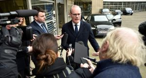 Tánaiste Simon Coveney briefs Irish journalists in Brussels on Monday, after a meeting with EU chief Brexit negotiator Michel Barnier. Photograph: John Thys/AFP via Getty Images