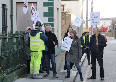 NO TO CO-LIVING: People Before Profit TD Richard Boyd Barrett and supporters take part in a demonstration against a controversial new Co-Living development on Eblana Avenue in Dún Laoghaire on Monday as demolition work on the site was scheduled to begin. Photograph: Nick Bradshaw