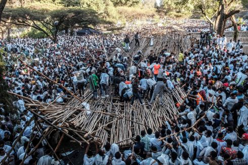 DEADLY COLLAPSE: A crowd scrambles to pull away scaffolding from a structure that collapsed, trapping and injuring dozens of people, during celebration of Timkat, the Orthodox Epiphany, in Gondar, Ethiopia, on Monday. At least 10 people were killed and about 100 injured when the wooden platform gave way. Photograph: Eduardo Soteras/AFP/Getty