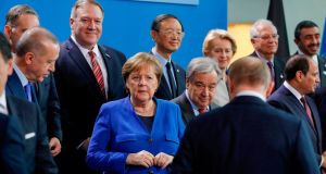 German chancellor Angela Merkel, regional leaders and Russian president Vladimir Putin (front right) gather during a peace summit on Libya at the chancellery in Berlin. Photograph: Getty