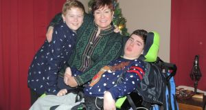 Tracy McGinnis with her sons Declan and Brendan, who requires constant care