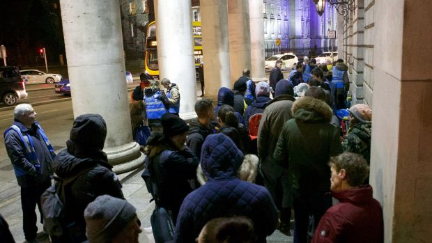 The homeless queue for food from Feed Our Homeless at College Green in Dublin. Photograph: Damien Eagers