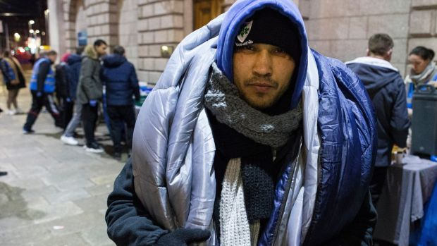 Dan Octivian (32), originally from Romania, with a sleeping bag over his shoulders, after receiving food provided by the Feed Our Homeless charity at College Green in Dublin. Photograph: Damien Eagers