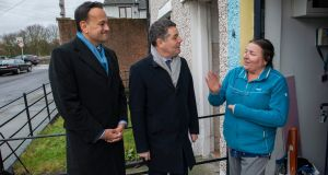 Taoiseach Leo Varadkar and Minister for Finance Paschal Donohoe speak to  Anne Donnelly on Hope Avenue as they canvass in Dublin Central. Photograph: Douglas O'Connor
