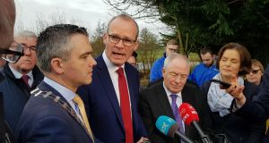Tánaiste Simon Coveney and Minister for Rural Affairs Michael Ring are pictured in Golden, Co Tipperary with Fine Gael candidates Garret Ahearn (left) and Mary Newman Julian (right).