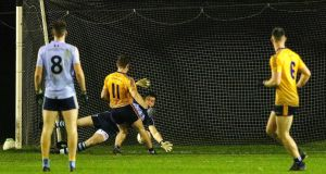 DCU's Michael Brannigan has his penalty saved before scoring the rebound against UCD. Photograph: Brian Reilly-Troy/Inpho