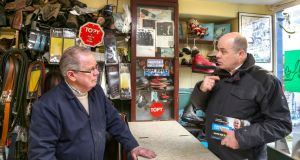 Denis Naughten, Independent candidate for the Roscommon-Galway constituency, speaks to Willie Burke in his shoe repair shop, during his canvass in Ballinasloe. Photograph: Joe O'Shaughnessy