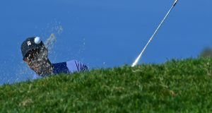 Tiger Woods plays a shot from a bunker on the 11th hole during the first round of the Farmers Insurance Open at Torrey Pines. Photo: Donald Miralle/Getty Images