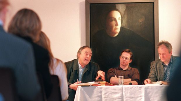 Redmond O' Hanlon, left, speaks at the Kate O'Brien Weekend in 1999 with James Heaney and Derek Cahill in the Hunt Museum, in Limerick, before a portrait of Kate O'Brien. Photograph: Dara Mac Dónaill