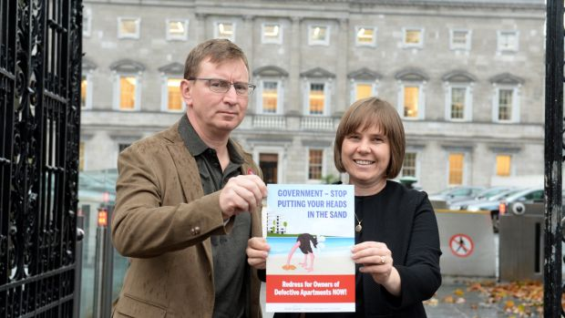 Andrew Prior and Kath Cottier from the Construction Defects Alliance outside Leinster House. Photograph: Dara Mac Dónaill/The Irish Times