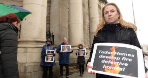 November 2019: Ciara Holland, owner of a defective apartment built by Tudor Homes, protests with supporters outside the Four Courts. Photograph: Dara Mac Dónaill/The Irish Times