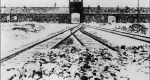 This file photo taken in January 1945 shows Auschwitz concentration camp gate and railways after its liberation by Soviet troops in Oswiecim, Poland.  AFP PHOTO / --/AFP/Getty Images