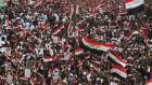 Thousands of Iraqis demonstrate in the heart of Baghdad on Friday  to demand the ousting of US troops from the country. Photograph:  Ahmad Al-Rubaye/AFP via Getty Images