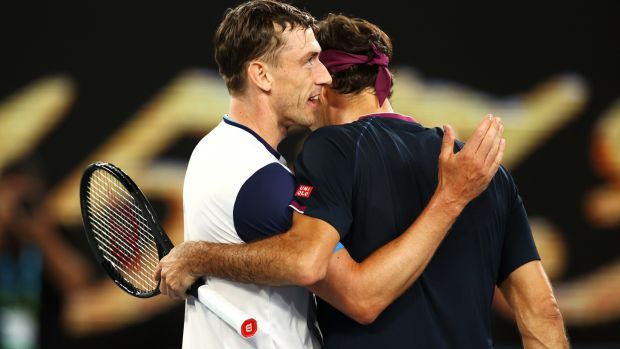 John Millman congratulates Roger Federer after his five-set win in Melbourne. Photograph: Cameron Spencer/Getty
