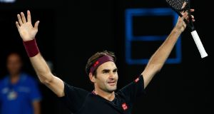 Roger Federer celebrates his five-set win over John Millman. Photograph: Darrian Traynor/Getty