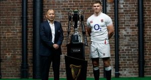 Eddie Jones with England captain Owen Farrell ahead of the Six Nations. Photograph: James Crombie/Inpho