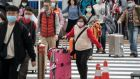 Chinese tourists  at Narita airport  in Japan.  Japan is one of the most popular  destinations for Chinese tourists during the Lunar New Year holiday. Photograph: Tomohiro Ohsumi/Getty Images