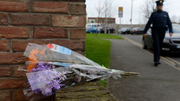 Flowers placed near the house where the bodies of Conor (9), Darragh (7) and Carla McGinley (3) were discovered. Photograph: Caroline Quinn/PA Wire