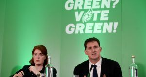 Green Party candidate Cllr Neasa Hourigan alongside party leader Eamon Ryan during the publication of the party's manifes  in Dublin on Saturday. Photograph: PA