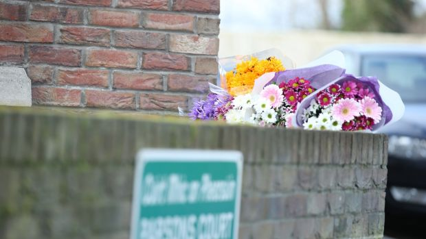 Flowers are seen outside the house at Parson's Court. Photograph: Collins