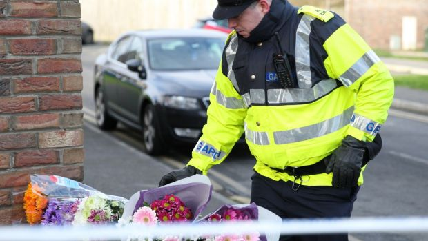 Flowers are seen outside the house where the bodies of three children were found in a house in Newcastle. Photograph: Collins