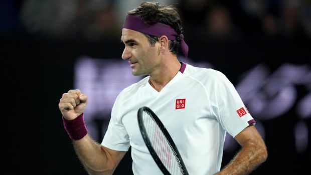 Roger Federer celebrates his fourth round win over Marton Fucsovics. Photograph: Michael Dodge/EPA