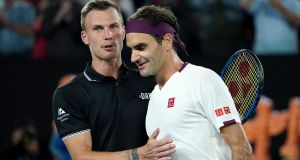 Marton Fucsovics and Roger Federer after their four-set clash in  Melbourne. Photograph: Michael Dodge/EPA