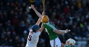 Westmeath's Niall Mitchell jumps with Johnny Coen of Galway. Photo: Tommy Grealy/inpho