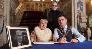 Nobel Peace Prize winner Betty Williams and actor Sharon Stone, with Lord Mayor of Belfast Daniel Baker signing a book of condolence for Seamus Mallon, on Saturday. Photograph: Presseye/PA Wire