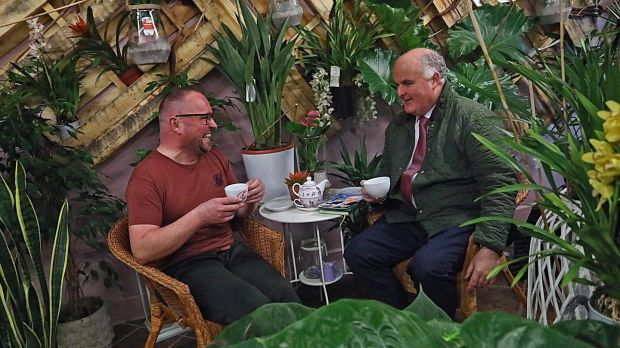 Fianna Fáil candidate Joe Flaherty chats to Stan Hromada at his florist's shop in Longford on Thursday morning. Photograph: Lorraine Teevan