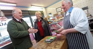 Election candidate Joe Flaherty with Longford butcher Christy Monaghan and his customer Katherina Connellan on Thursday morning. Photograph: Lorraine Teevan