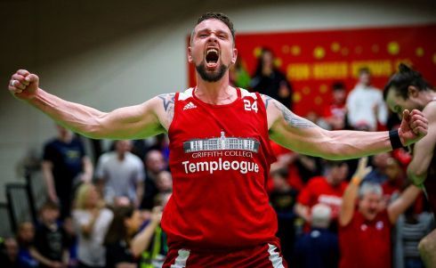HOOPS: Griffith College Templeogue's Jason Killeen celebrates at the final whistle after taking on DBS Eanna in the Hula Hoops Men's National Cup Final at the National Basketball Arena, Tallaght on Saturday. Photograph: Tommy Dickinson/Inpho