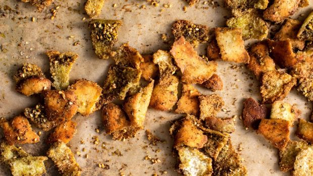 Chunks of pita bread, tossed with za'atar for flavour. Photograph: Andrew Scrivani/The New York Times