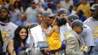 In 2009 Kobe Bryant of the Los Angeles Lakers celebrates victory with his family following game five of the NBA Finals. Photograph: Getty Images