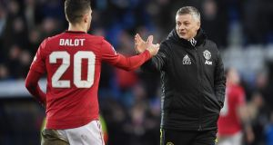 Ole Gunnar Solskjaer with goalscorer Diogo Dalot after Manchester United's win at Tranmere. Photograph: Gareth Copley/Getty