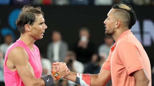 Rafael Nadal and Kick Kyrgios shake hands after their clash in Melbourne. Photograph: Jonathan DiMaggio/Getty